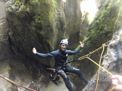 Rapeling down a waterfall in Slovenia