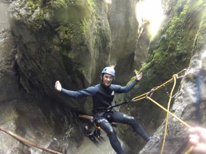 Rapeling down a waterfall in Slovenia